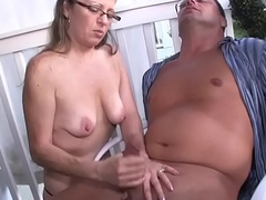Matured housewife wanking her hubby outdoors