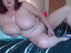 British mega super grown-up Sarita with natural 40kk tits