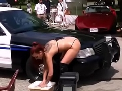 Bikini carwash band dance near prerogative car