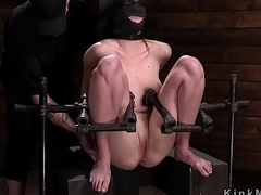 Slave spanked and flogged in bondage